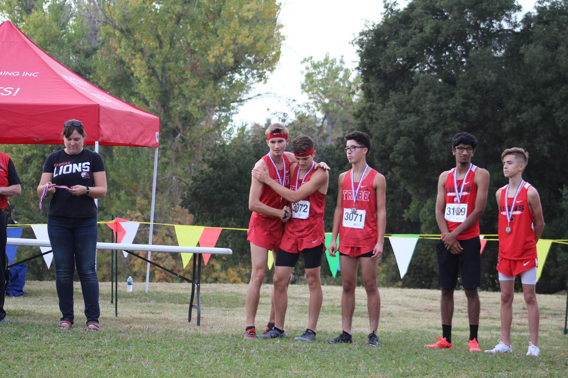 Michael Eggert shaking teammate's hand after receiving medal