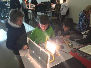 Students look at solar energy displays at WMU.