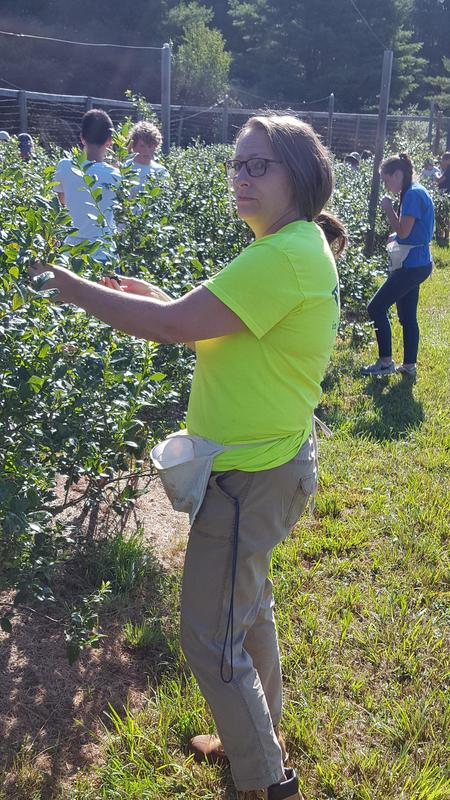 Teacher Ms. Theresa Long works on a garden during the OLSH Mission Trip