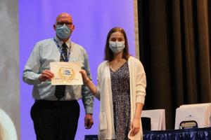 Senior Julia Pitolaj accepts Valedictorian Award from high school principal, Mr. Matt Mahoney at Ruben A. Cirillo High School Academic Awards 2021