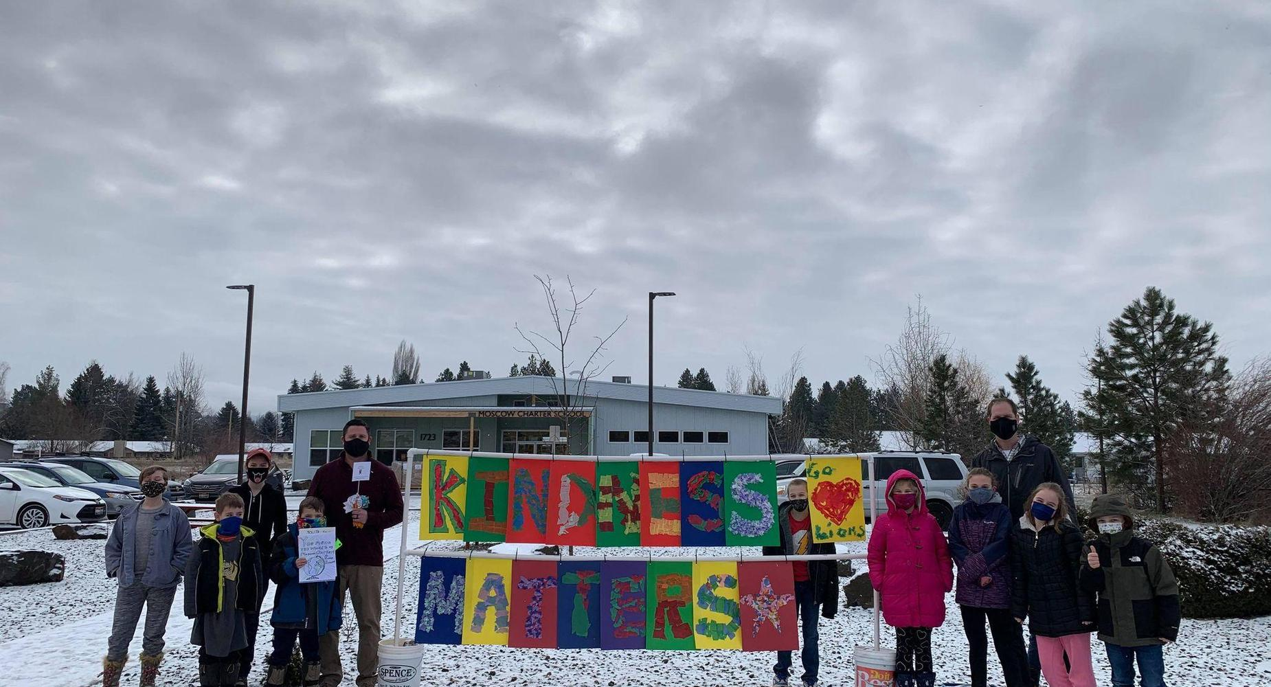 sign that says kindness matters with students