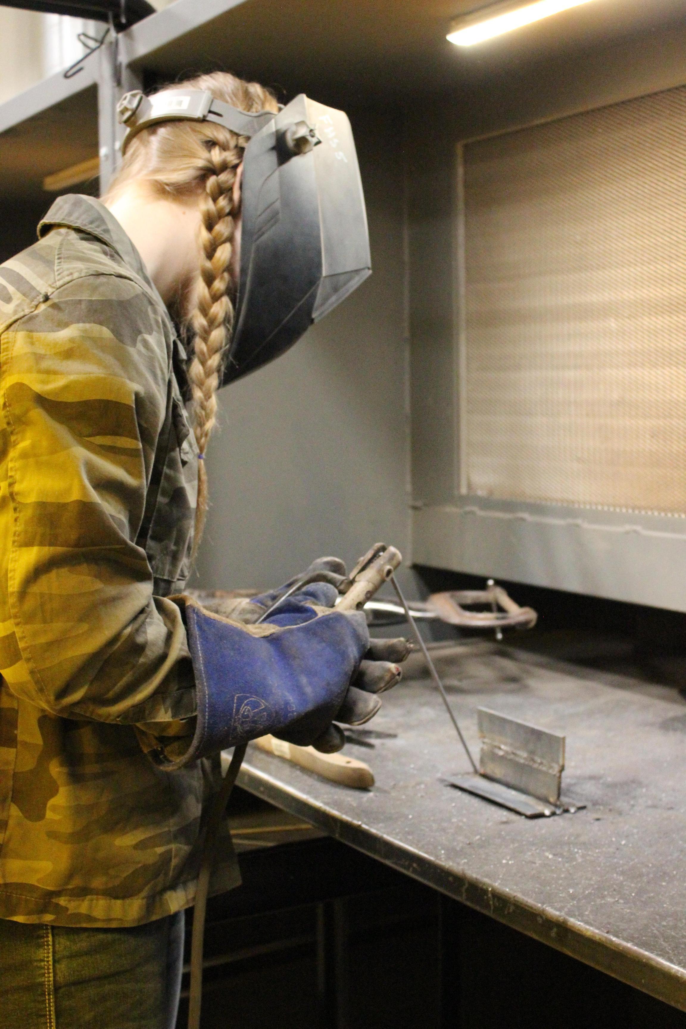 female welding student