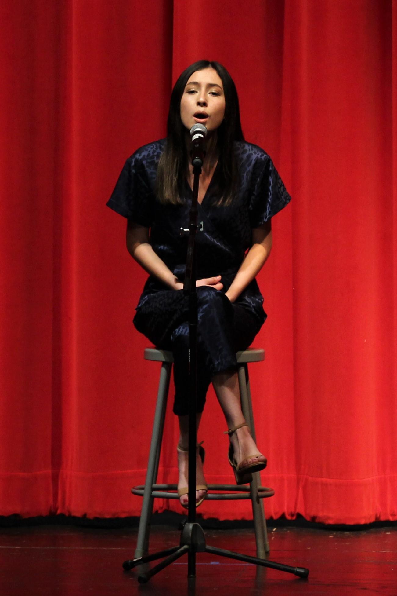 Lexi Montez singing at the talent show