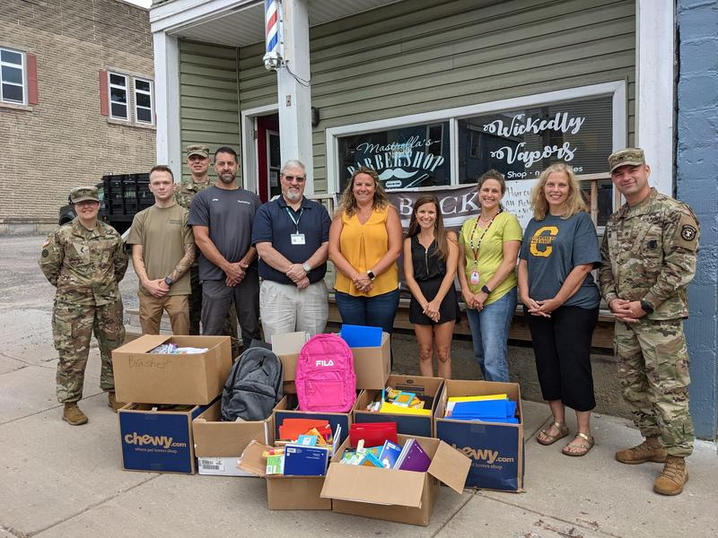 Photo of HCSD community partners and the donation of school supplies.