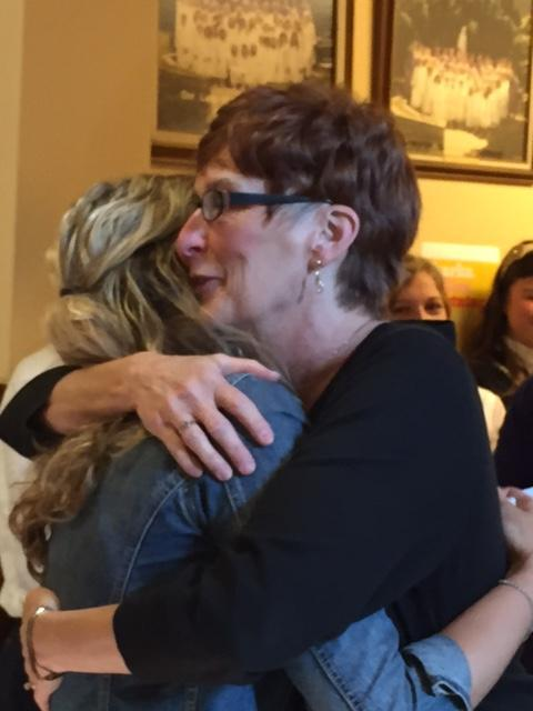 photo of teacher hugging student