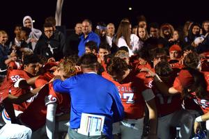coach prays with team