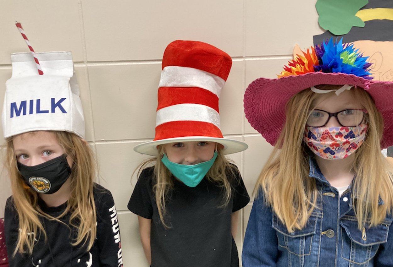 students in funny hats