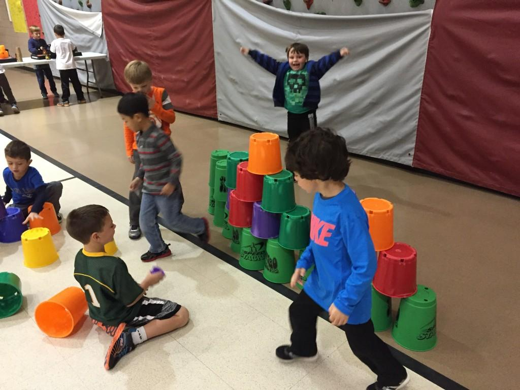 students celebrate their stack of pails