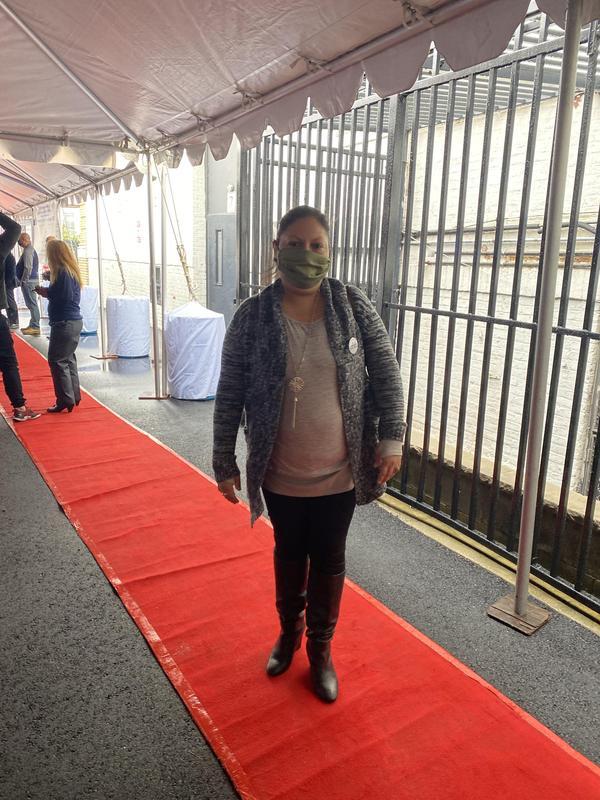 Parent walking on red carpet