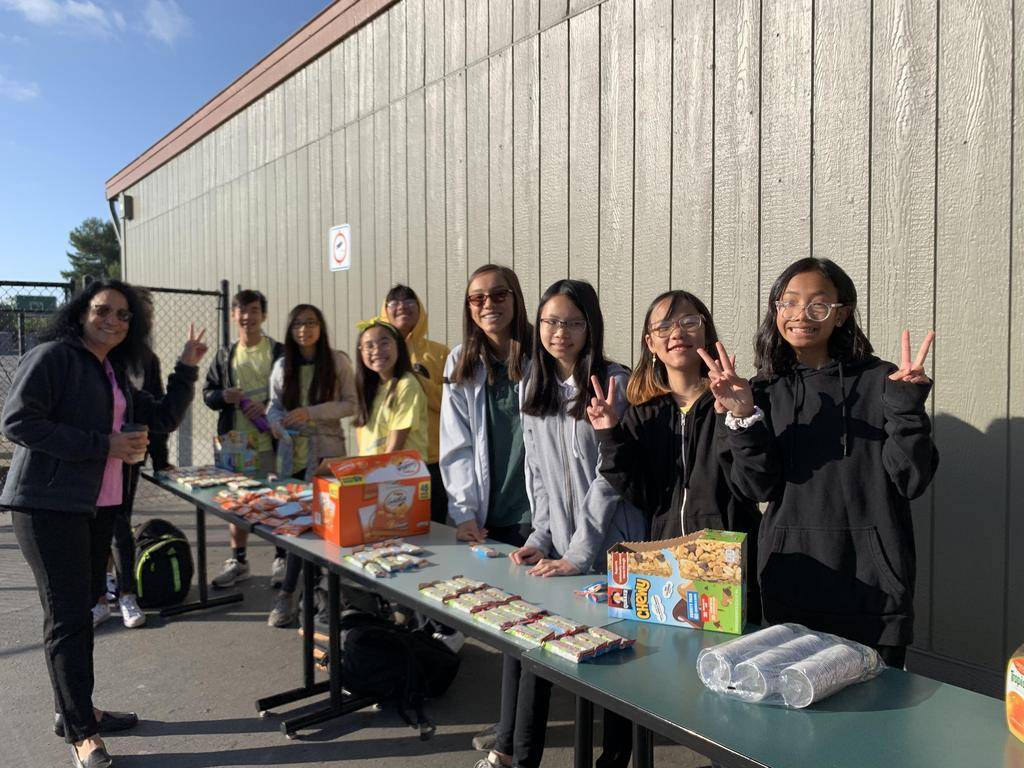 ARK club members handing out snacks to help destress the SBAC test.