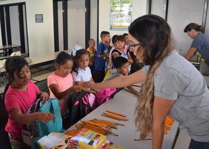 Roosevelt Elementary students collect new school supplies donated by Copper Moose Fitness on Aug. 24.