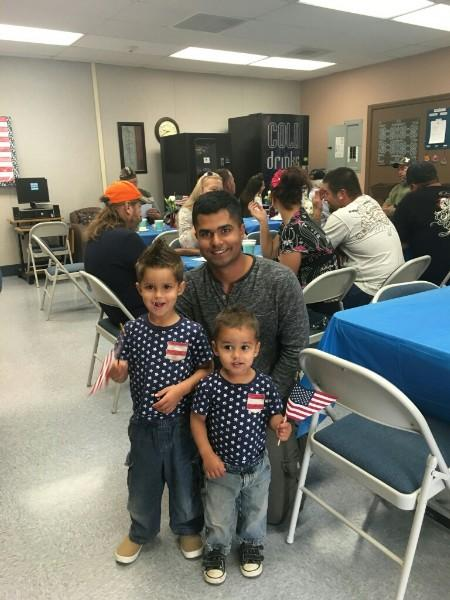 Father who is currently serving in the armed forces with his two children
