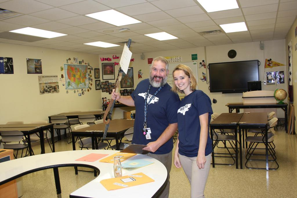 Two teachers prepare for the return of students on the first day of school at WECHS