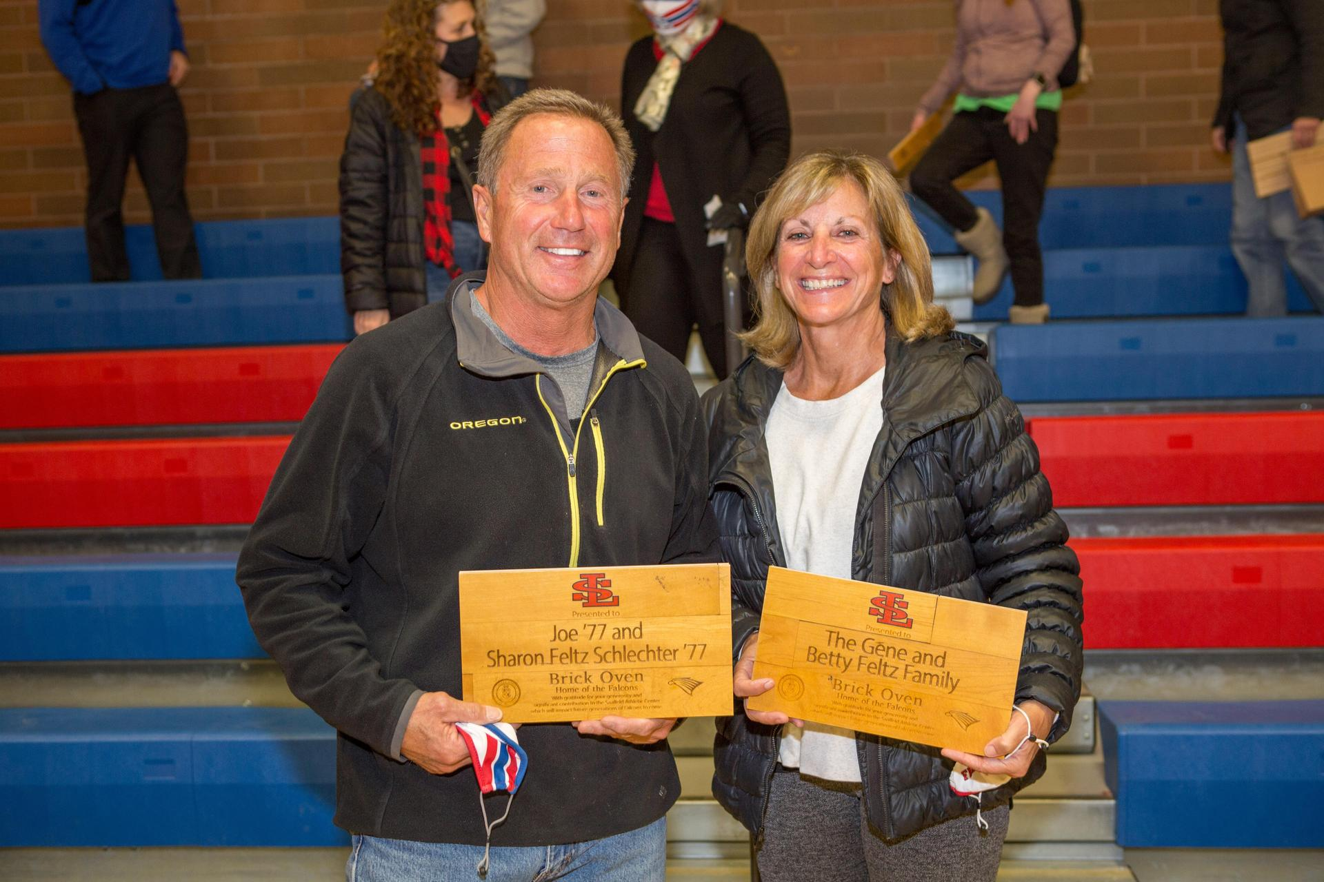 donors displaying gym floor plaques