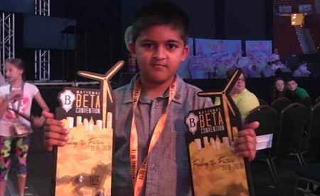 Student holding trophies at National Beta Club Convention in Oklahoma City