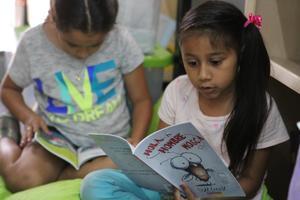 Female students reading