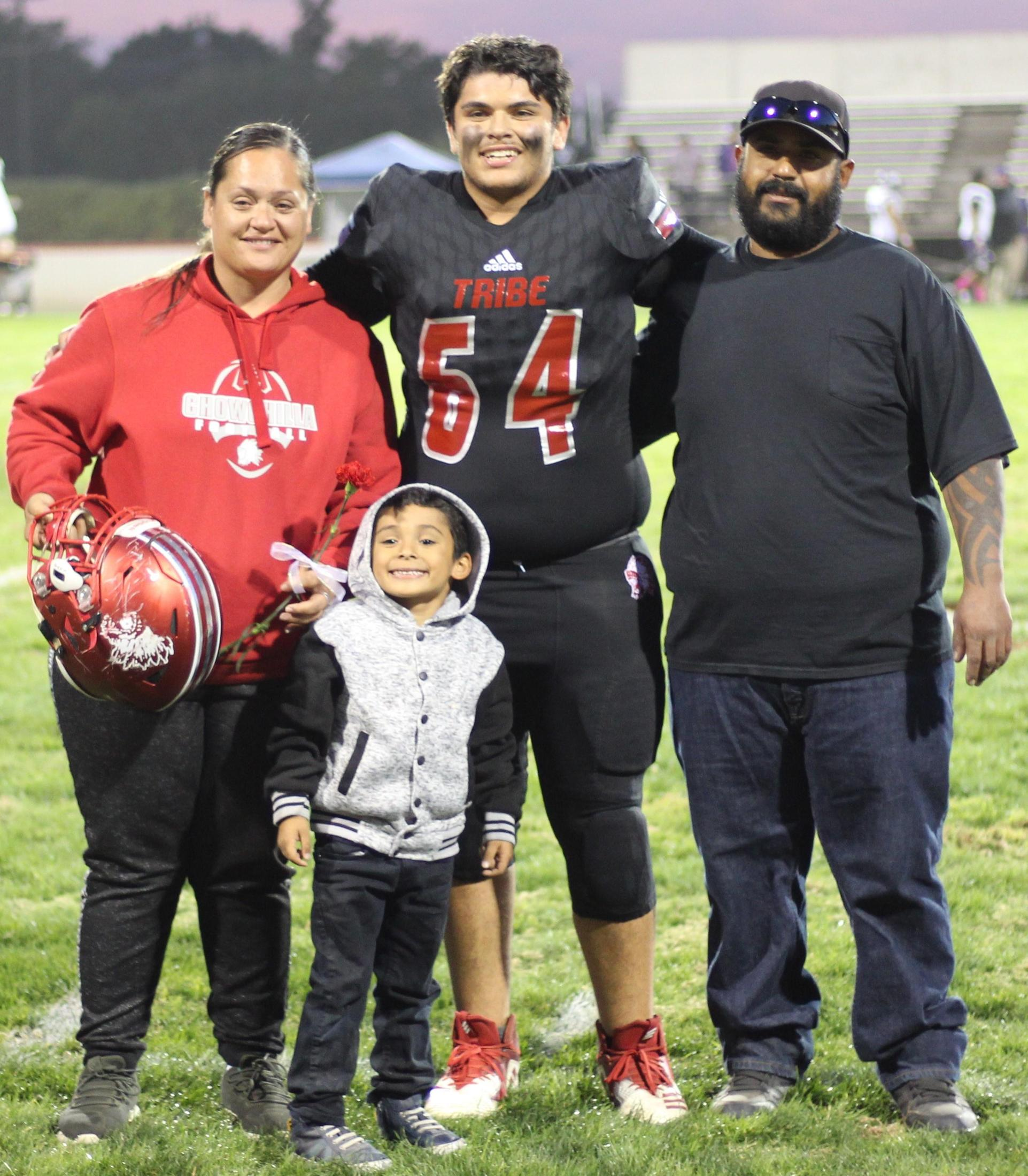 Senior football player Jacob Arteaga and his escorts.