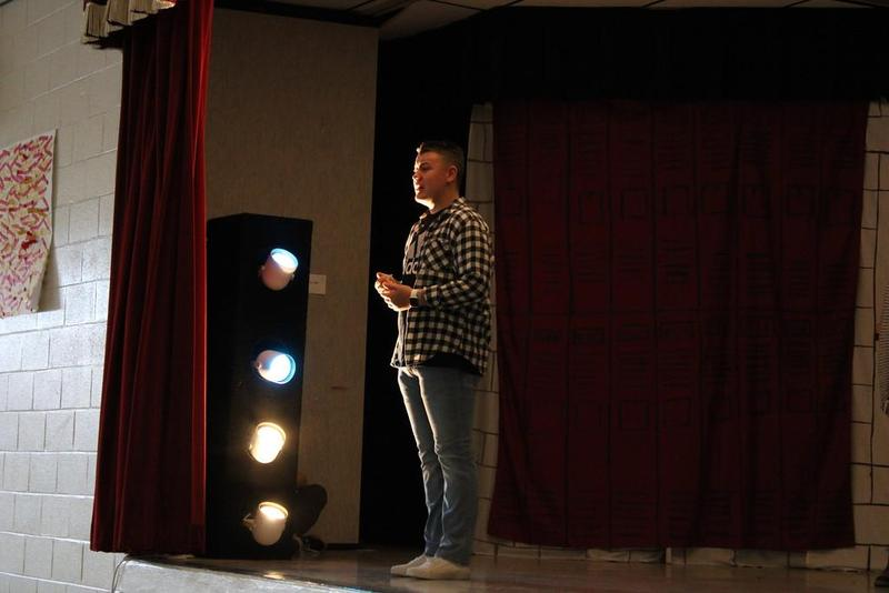 student standing on stage
