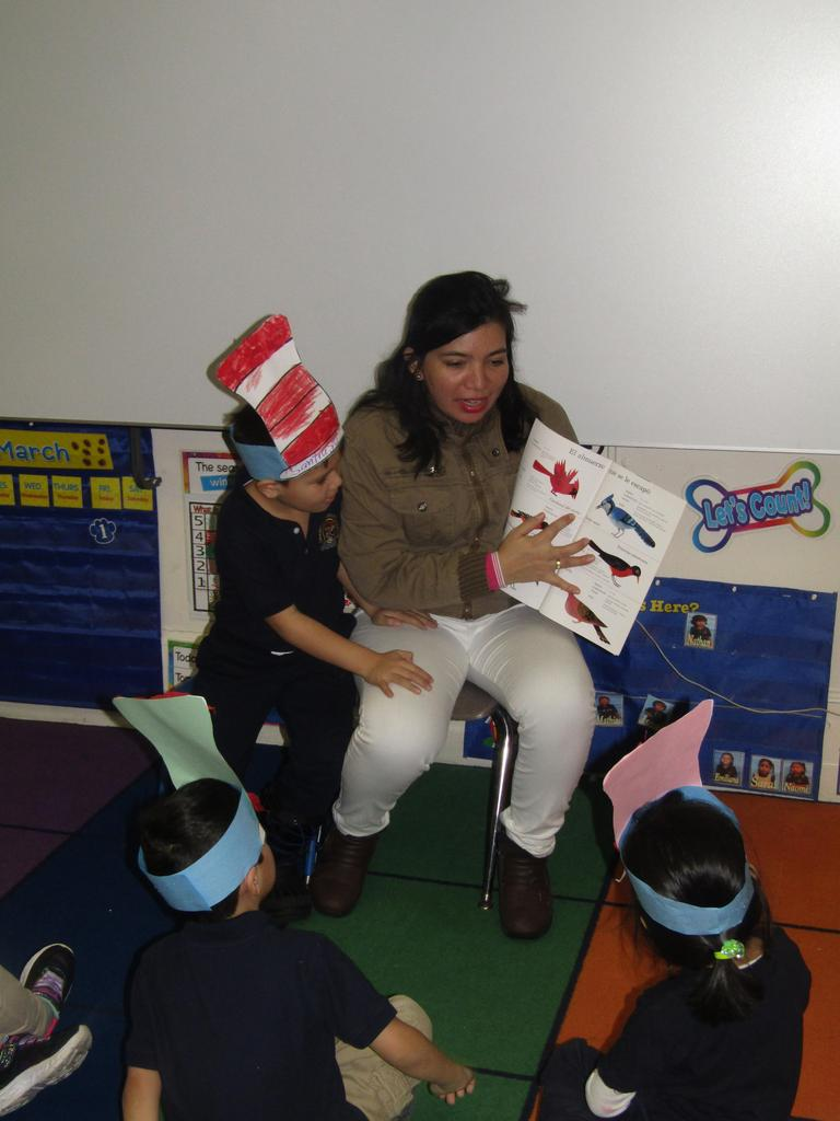 mother reading to a class with her son next to her