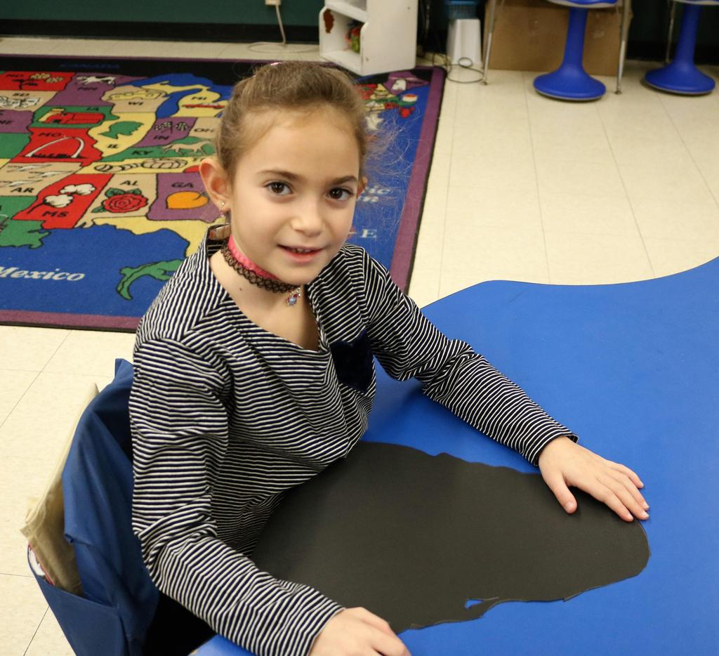 Photo of Tamaques student working on 100th Day activity.