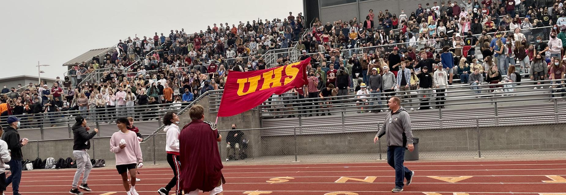 UHS Spirit flag waved in front of student body in the stadium.