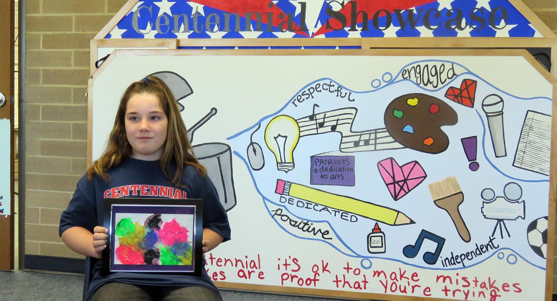 Centennial Elementary fourth-grader Aydia Jackson displays her artwork.