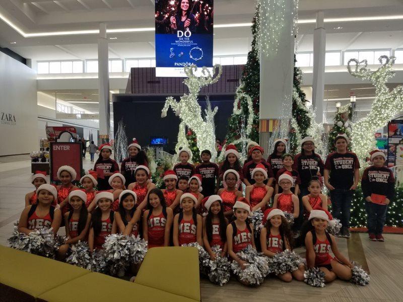cheerleaders with santa hats.