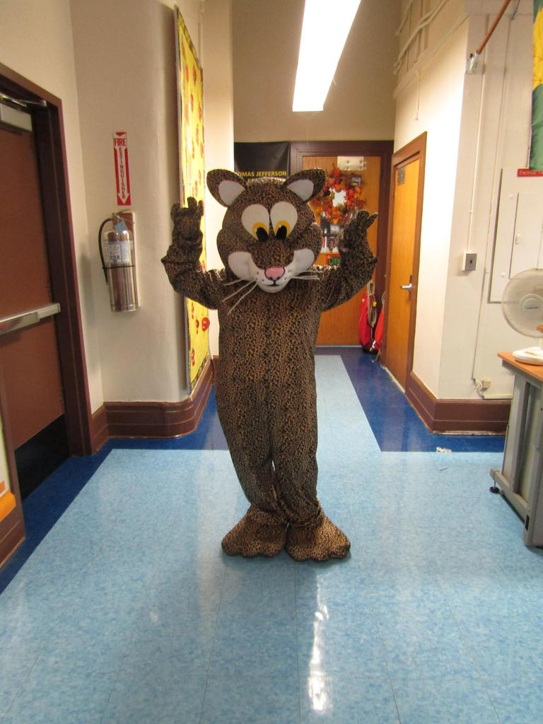 school mascot jaguar happily posing in main hallway