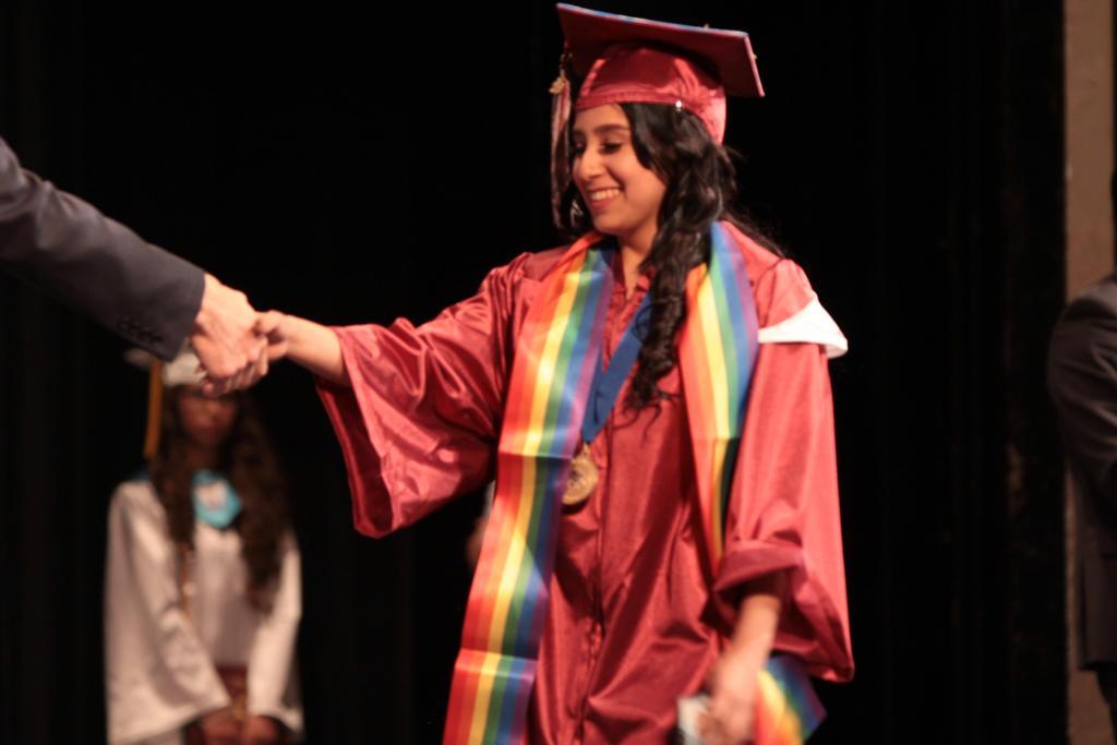 Graduates receiving a diploma