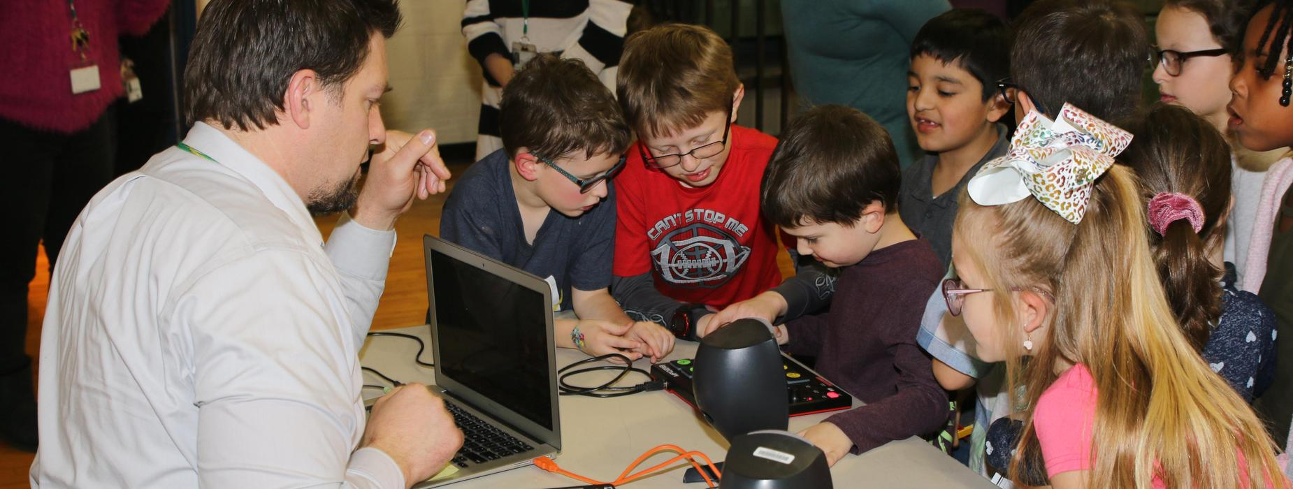 Students with a computer game.