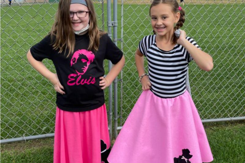 students dressed in 50's outfits