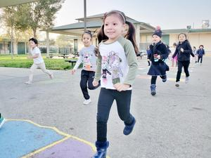 Kindergarten students running a race.