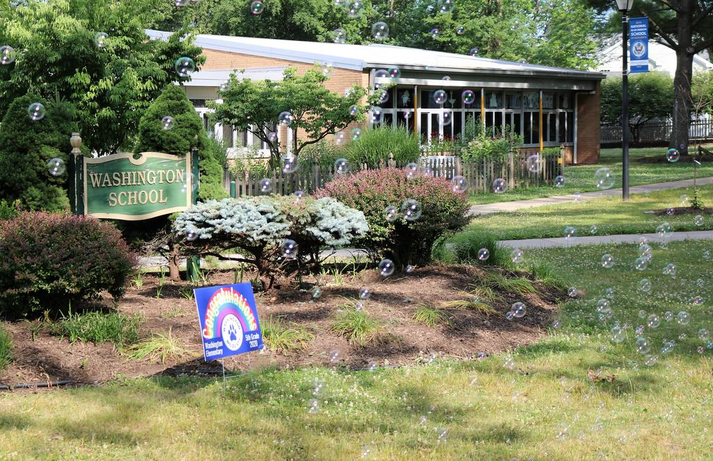 Photo of bubbles in front of Washington School sign, plus congratulations sign.