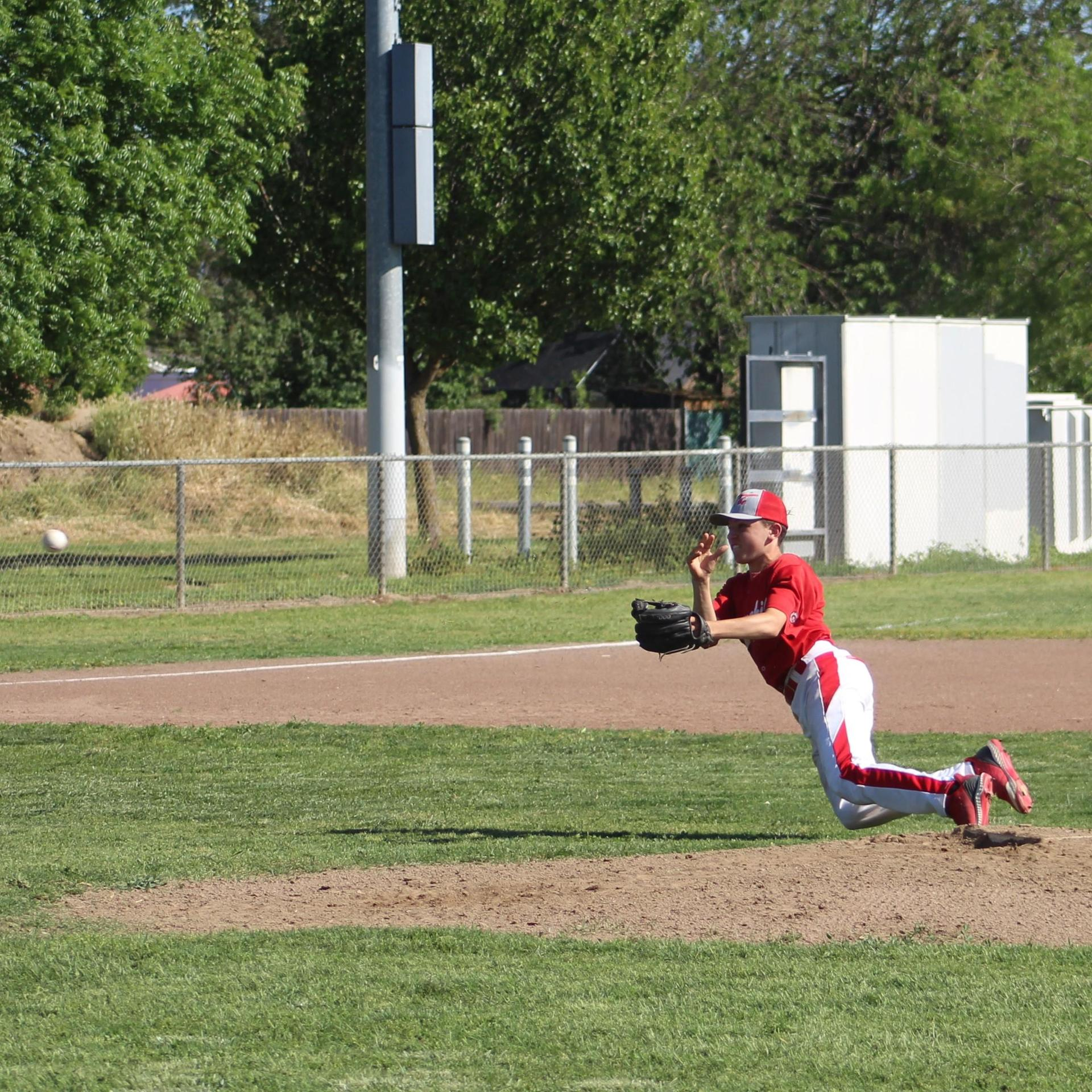 JV baseball players in action against Washington Union