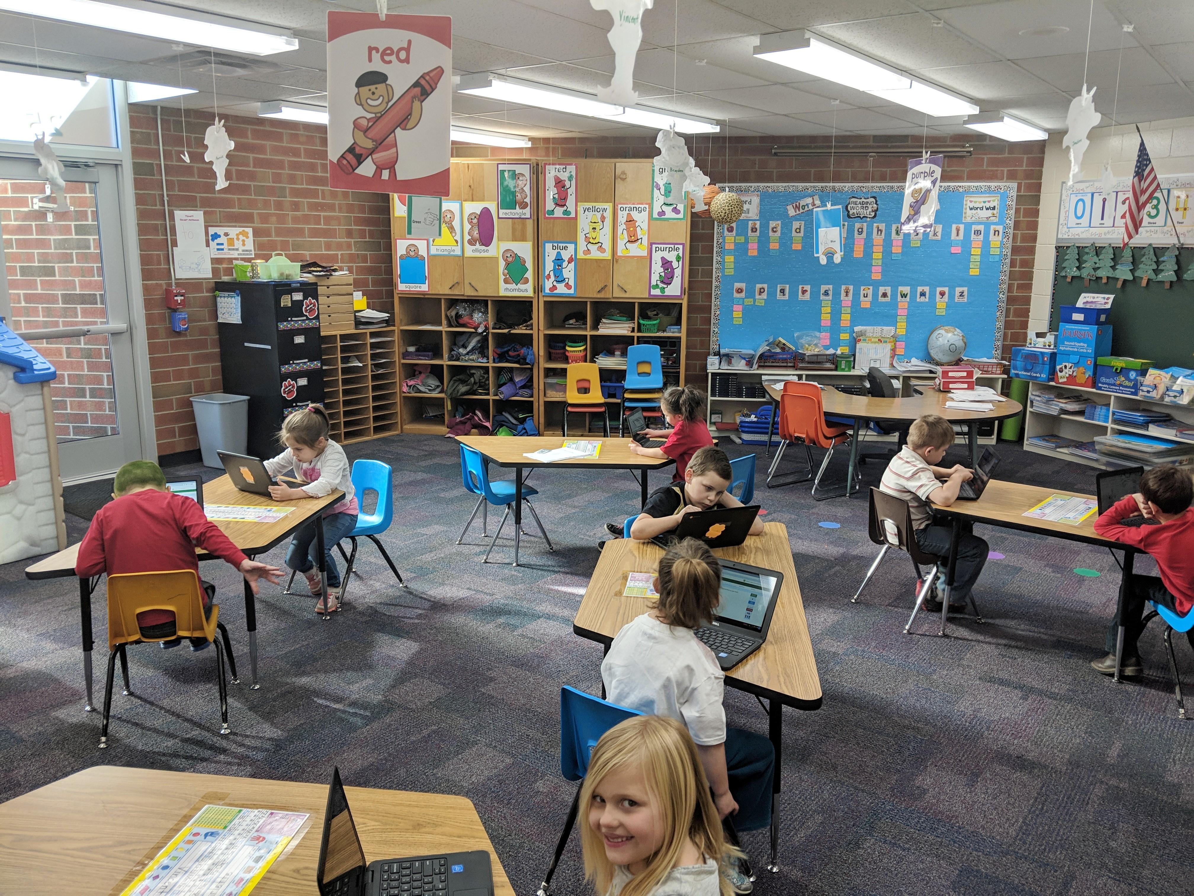 Kindergartners using their new Chromebooks in their classroom.