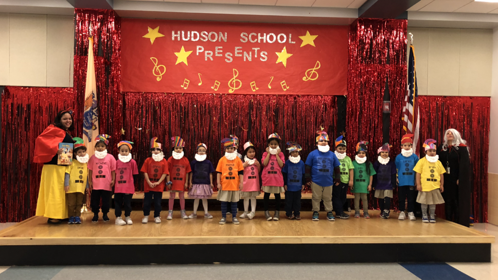 students and teachers dressed as snow white and the 7 dwarves