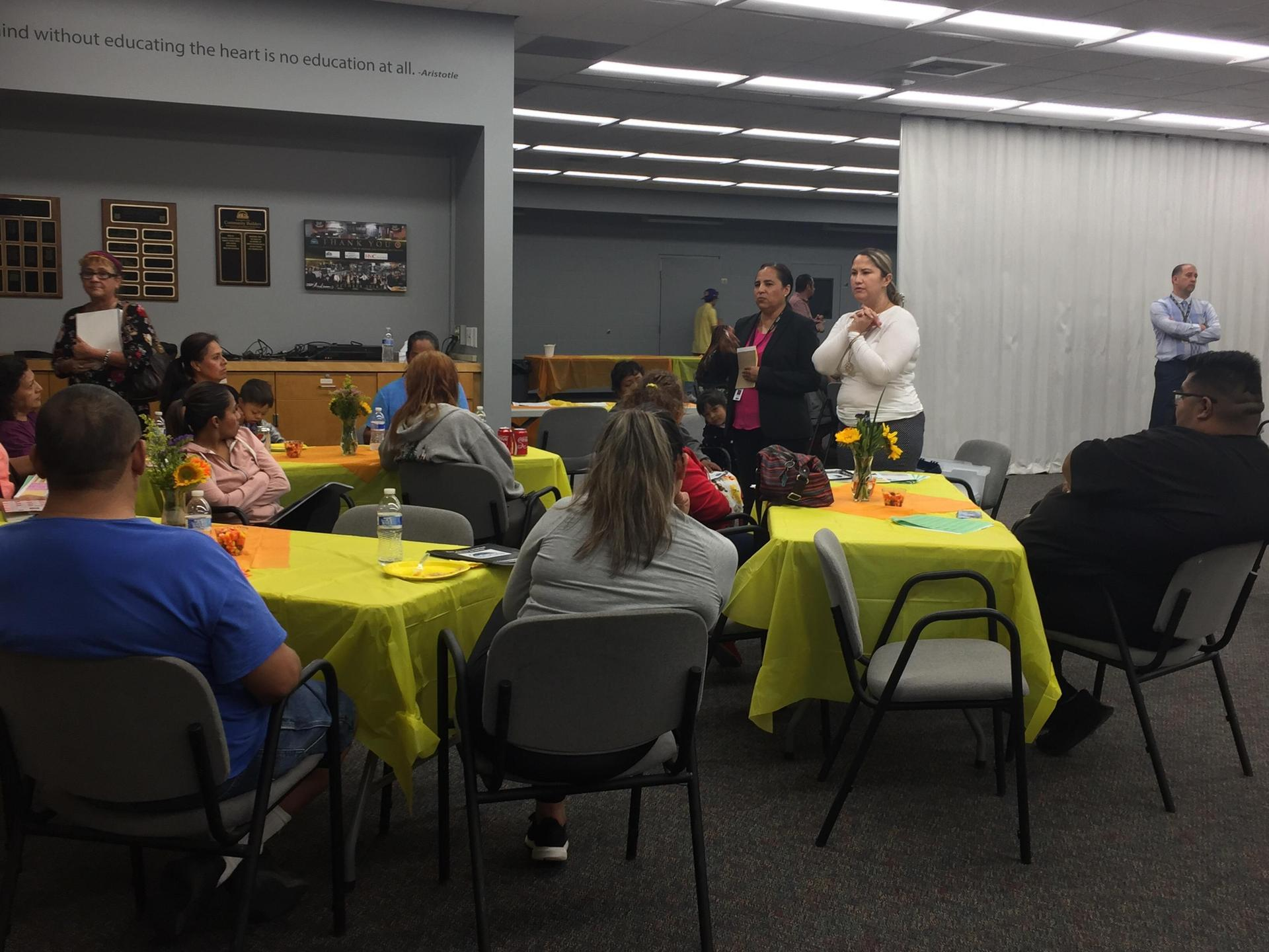 Family & Community Specialist, Carla Adame and Special Education Interpreter, Olympia Orozco addressing parents about available resources at SJUSD