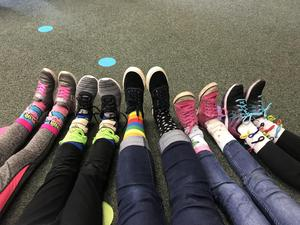 A group of people showing off their crazy socks