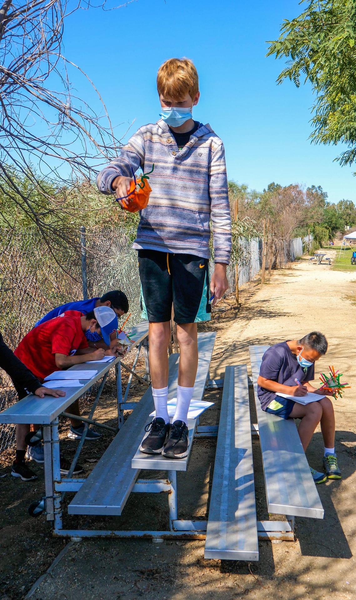 """Renaissance school students conducting an """"egg drop"""" experiment"""