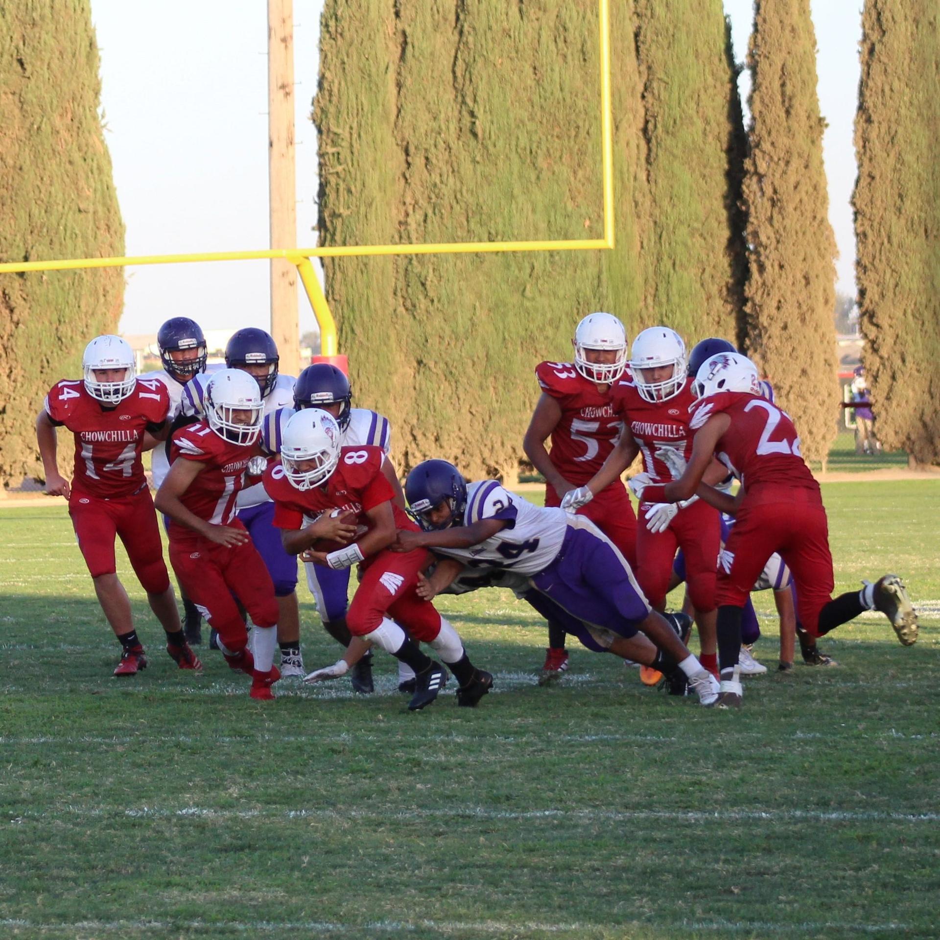 Junior Varsity boys playing football