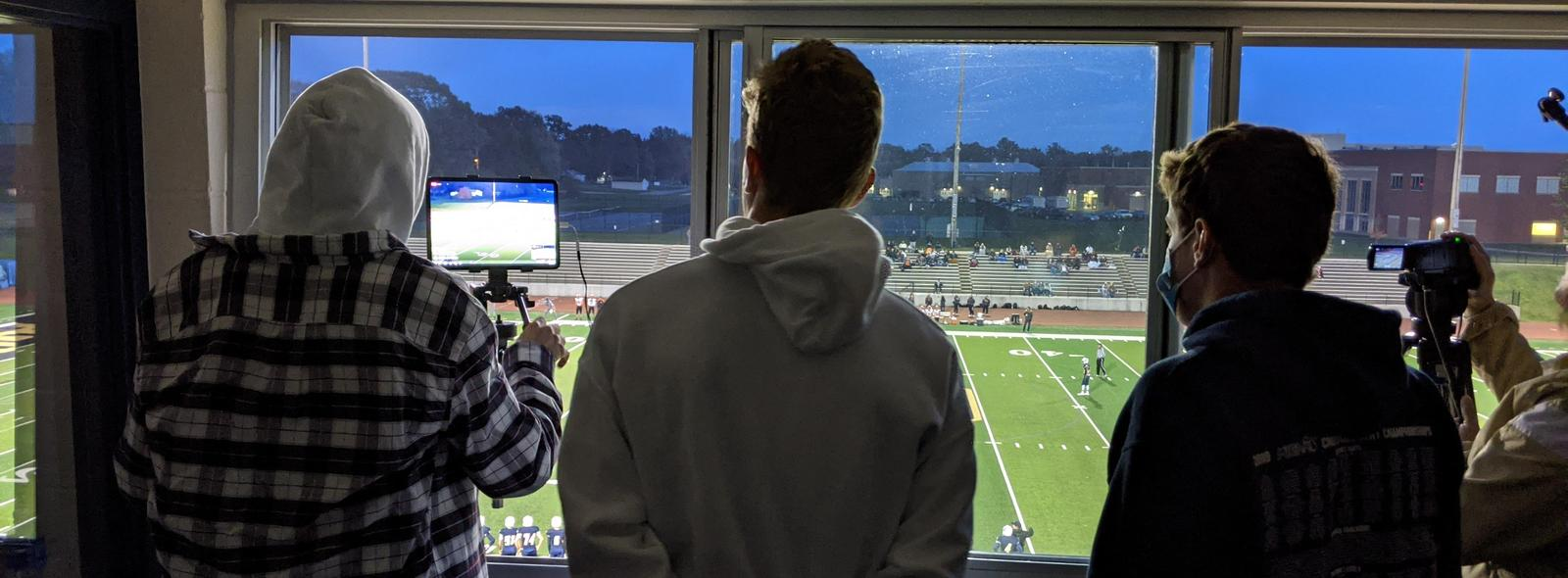 camera crew at the football game, view from the press box