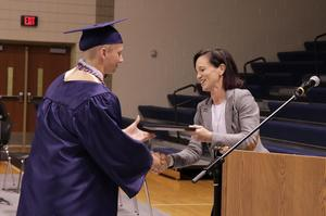 West Point's Amy Rummel hands Grile his certificate during swingout.