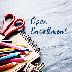 Pens, scissors, notebook, Open enrollment words
