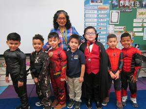 Aide with the boys of the class dressed in different costumes