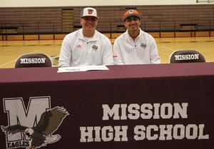 Eddie and Andres side by side at the signing table