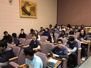 MathCounts team members sit in chairs in an auditorium during Regional Competition.