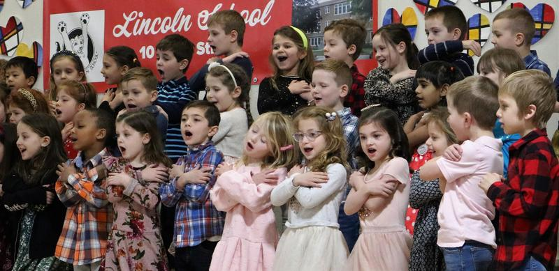 Photo of Lincoln kindergartners performing for grandparents and special guests.