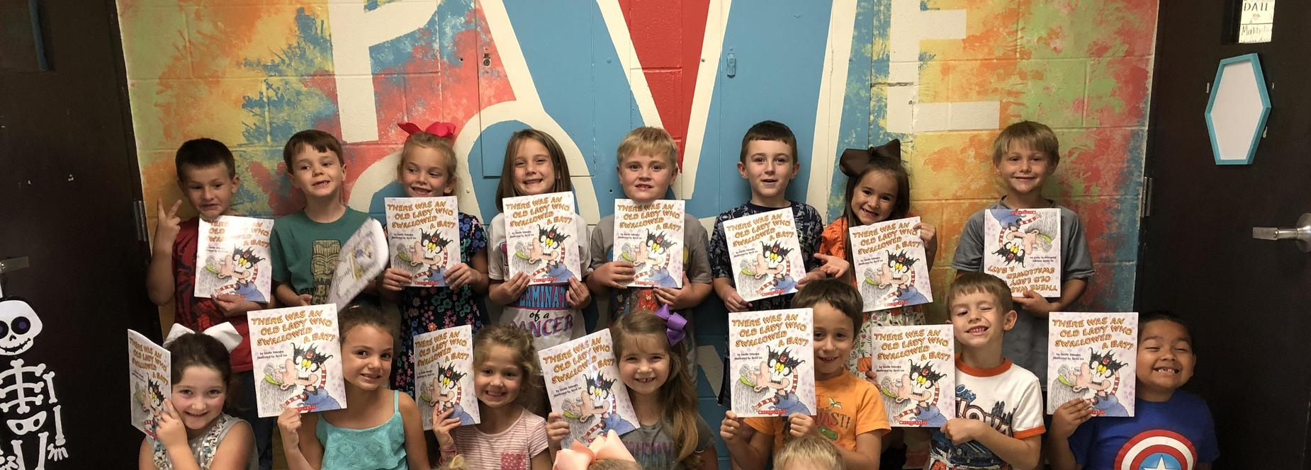 1st Graders Holding Books
