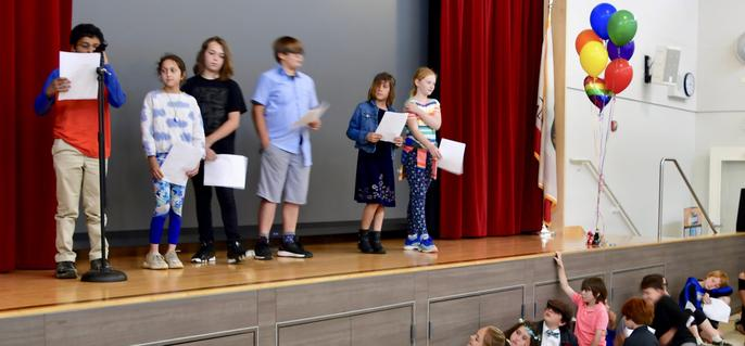 Poets at 5th Grade IB Exhibition assembly