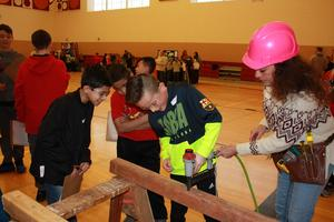 photo of students with a nail gun.